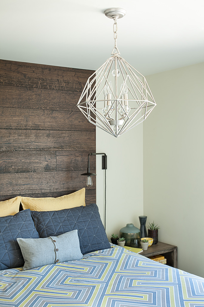 detail of modern white chandelier in bedroom