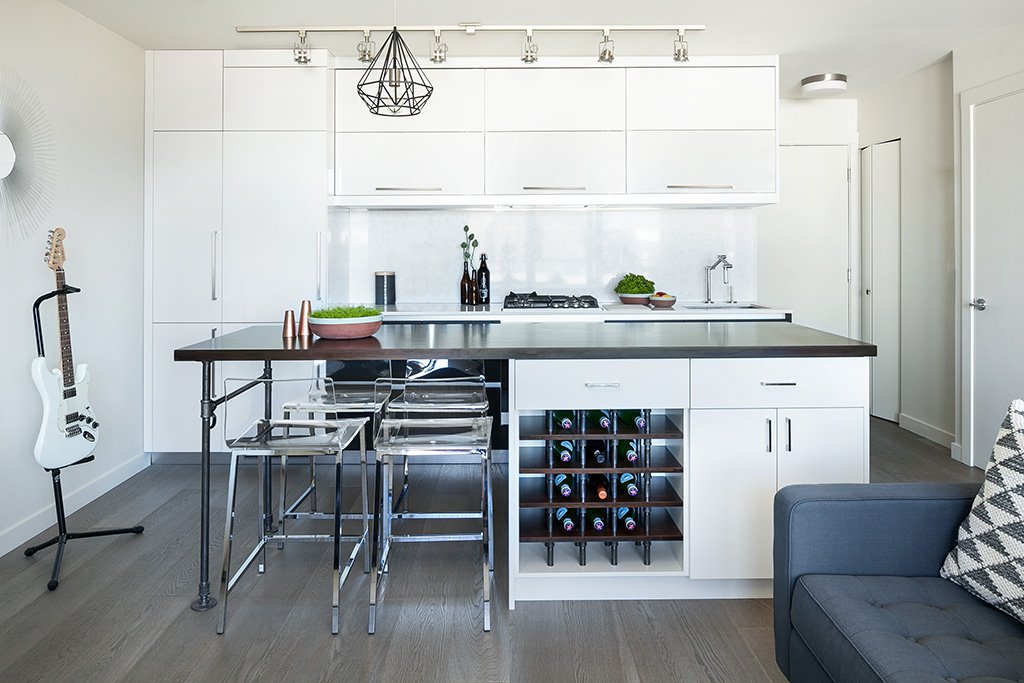modern white kitchen with dark wood bar