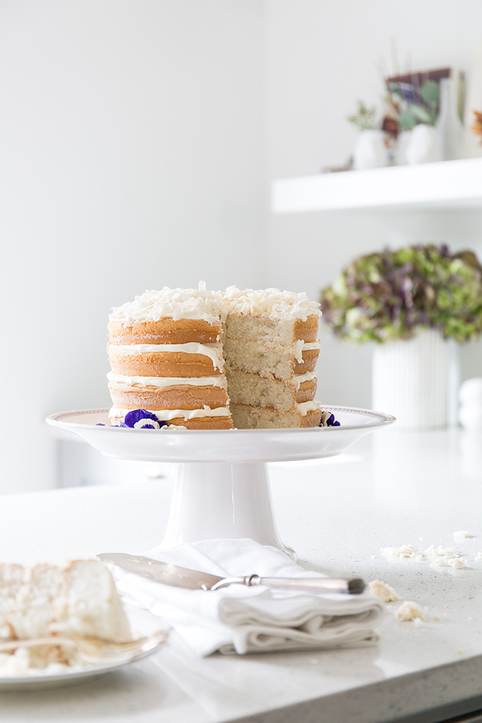 a close-up shot of a layer cake with a slice cut out