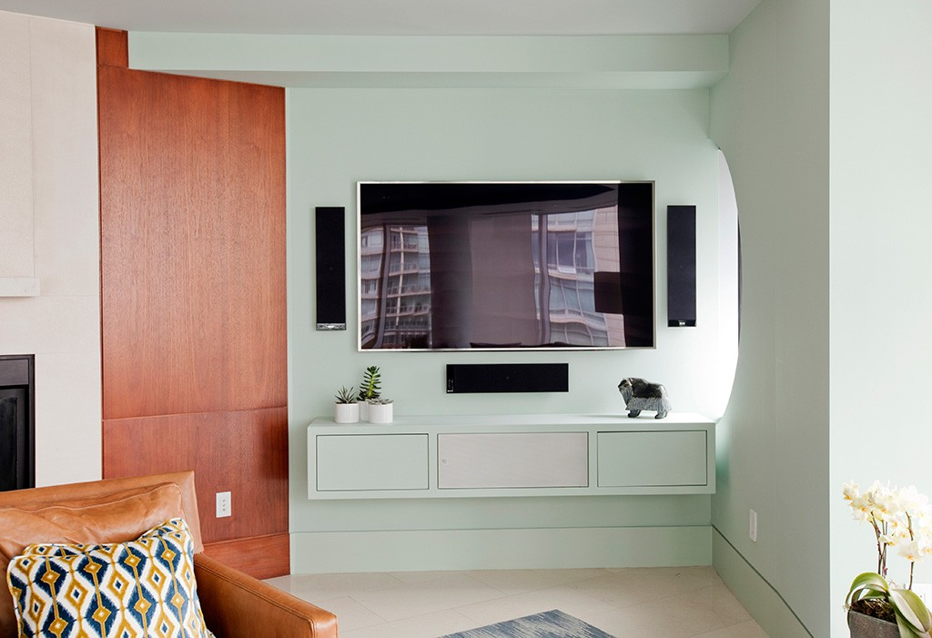 View of a living room TV with pale green walls.
