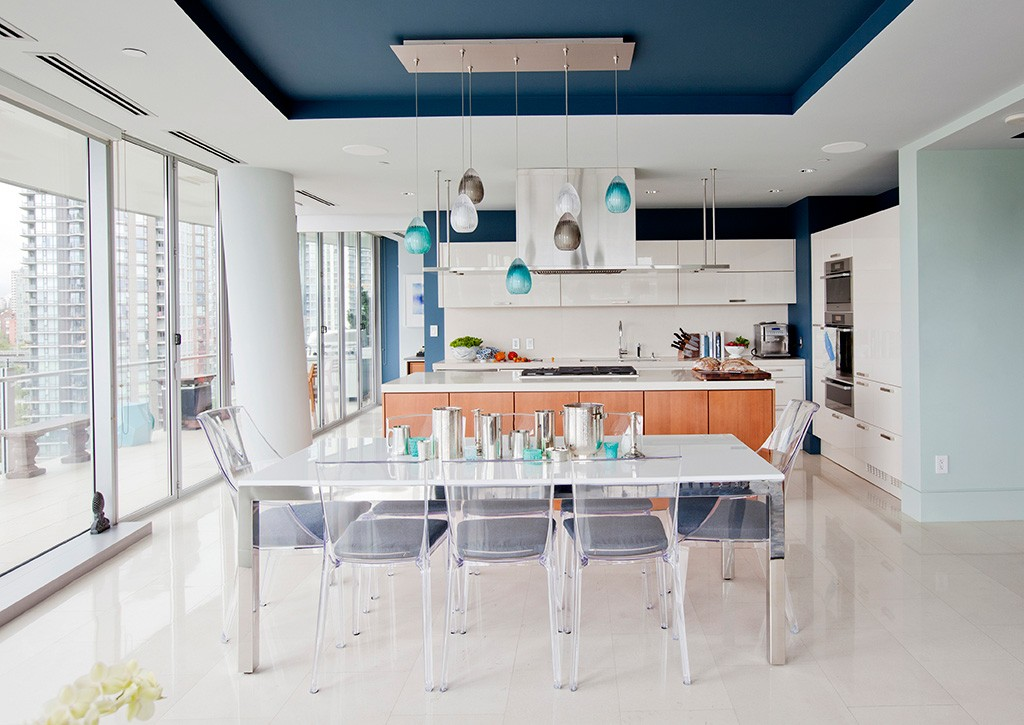 a dining table, with a modern kitchen in the background