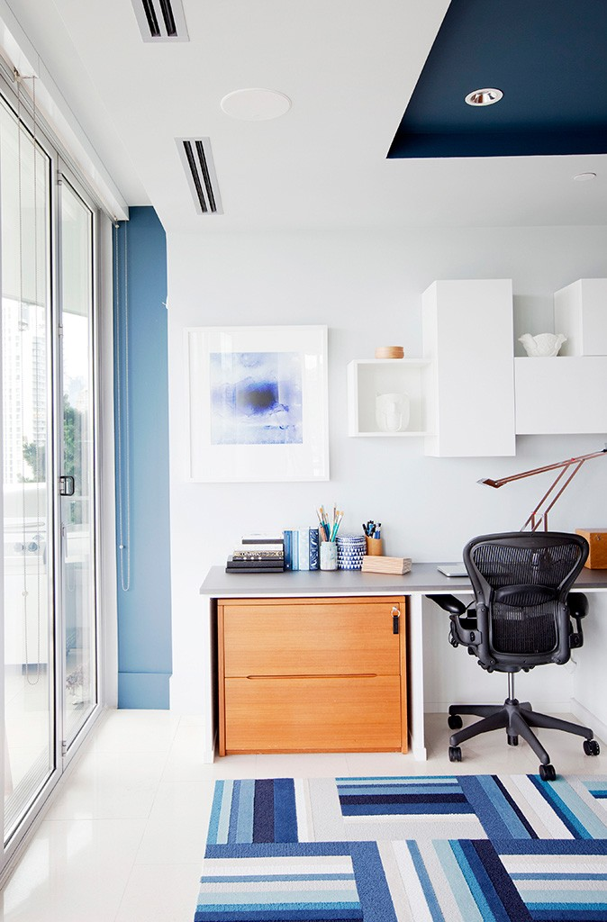 a desk in a blue and white office area