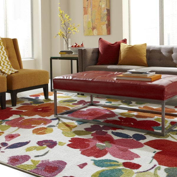 A bold floral rug in warm tones