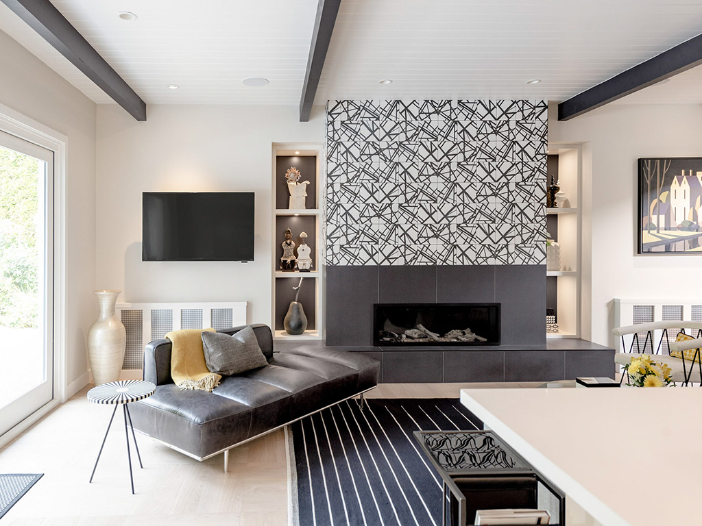 A modern living room with a dramatic tiled fireplace