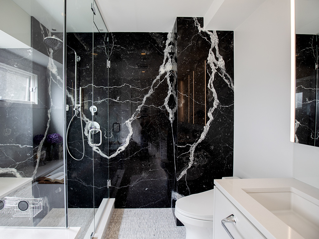 Black marble wall in a modern white bathroom